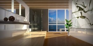 a modern looking apartment with the sea visible through the window
