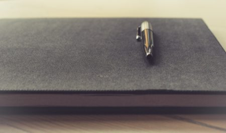 a pen on a notebook.