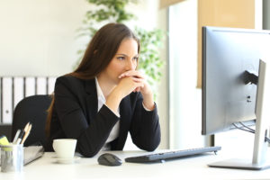 businesswoman concentrating on her computer