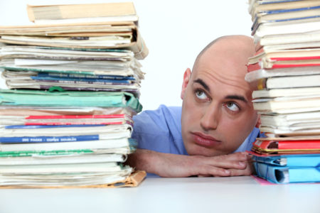 a man with a pile of paperwork