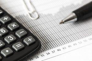 a calculator on a balance sheet