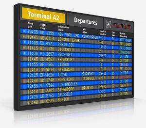 An airport terminal departure board