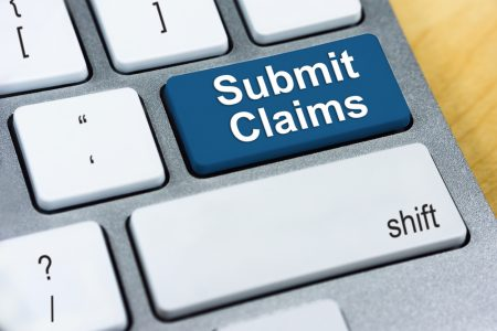 "Keyboard with ""Submit Claims"" key."