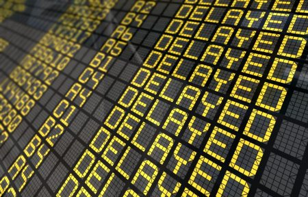 Delayed flights in flight status board.
