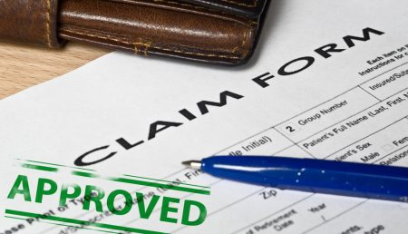"Claim form with ""approved"" stamp."