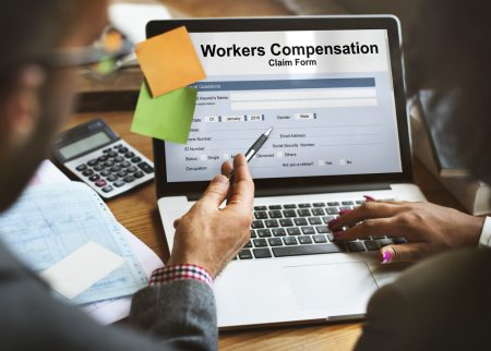 Worker's compensation claim form shown on a laptop..